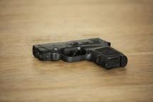 hand gun on a wood floor