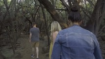 people walking through the woods