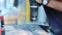a man using a drill