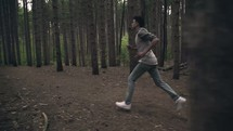 man running in the woods