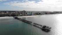 aerial view over a broken pier