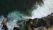 waves washing over rocky shore