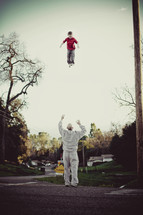 Father throwing son in air