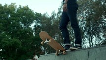 teen boy skateboarding on a ramp