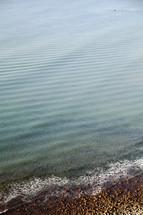 tide washing onto a rocky shore