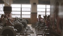 women on rowing machines