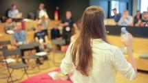 a woman leading a seminar