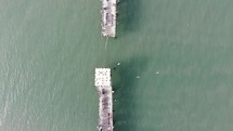 aerial view over an old broken pier