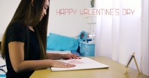 a girl coloring a red heart