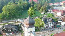 aerial view over a church and suburbs