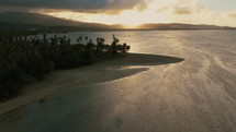 aerial view over a beach at sunrise