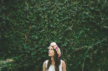 woman wearing a crown of flowers in her hair