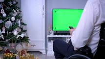 a person streaming a worship service at Christmas
