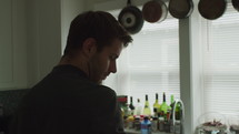 a man standing in a kitchen worrying