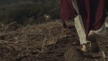 woman walking through wastelands