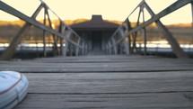 a woman walking on a pier