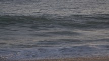 waves crashing onto a shore
