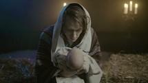 Joseph holding baby Jesus