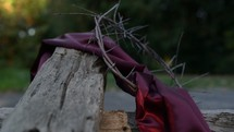 purple shroud and crown of thorns on a cross