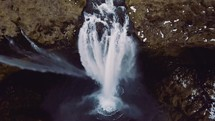 water flowing off a steep cliff in a waterfall