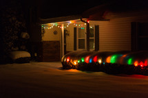 Christmas lights in snow