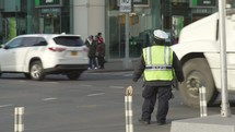 NYPD officer directing traffic