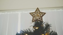 star on the top of a Christmas tree