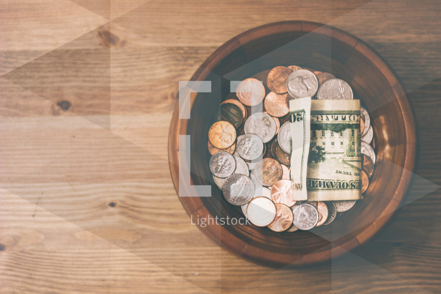 coins and cash in a bowl