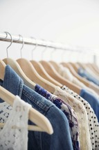 rack of clothes on hangers