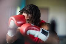 a man punching a punching bag