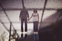 a couple reflected on water