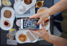 taking a picture of breakfast with a cellphone