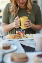 woman eating breakfast and praying before her meal