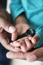 skeleton key in a toddler's hand
