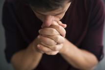 overhead of a man in prayer