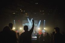 fans in a audience praising God at a worship service