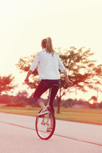 woman riding a unicycle