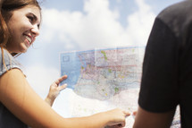 man and woman pointing to a map