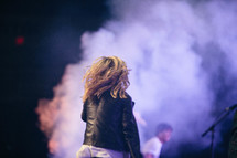 teen girl singing on stage