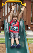 a child sliding down a slide