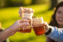 cheers with mason jar glasses
