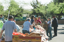 people distributing boxes of fruits and vegetables
