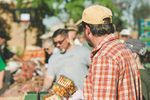 people shopping at a farmers market
