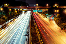 streaks from moving cars on a highway at night