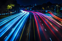 streaks of headlights and taillights on a highway at night