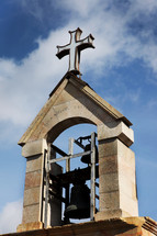 cross on top of a bell tower