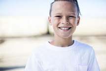 head shot of a smiling preteen boy