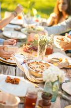 family thanksgiving dinner outdoors