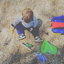 a child playing in gravel