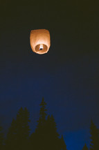 paper lantern in the night sky